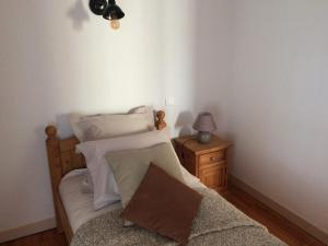 Un ou plusieurs lits dans un hébergement de l'établissement La Maison de Valentine
