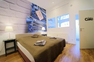 A bed or beds in a room at Planet Berlin City Apartments