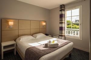 Ein Bett oder Betten in einem Zimmer der Unterkunft Les Villas du SPA