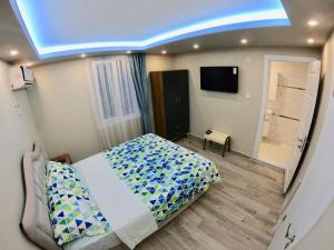 A bed or beds in a room at PASHA APART~BOUTİQUE HOTEL/YALOVA