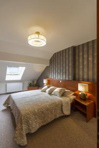 Postelja oz. postelje v sobi nastanitve Duplex Penthouse Aparthotel Rosa