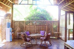 Balkon atau teras di Meno Island Villas