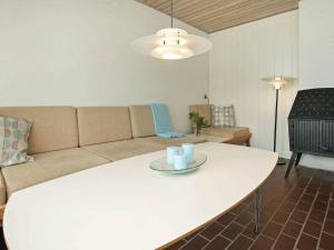 A seating area at Three-Bedroom Holiday home in Farsø 8