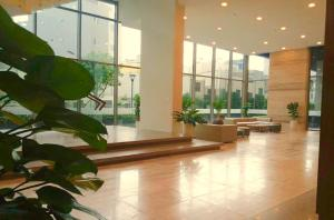 The lobby or reception area at Ao Homestay - Millennium