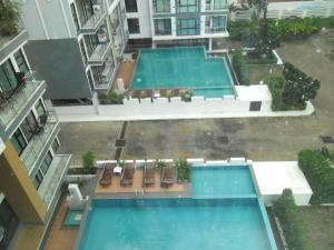 Вид на бассейн в NEOcondo @ PATTAYA или окрестностях