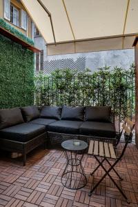 A seating area at Splendido monolocale nel cuore di Brera