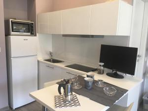 A kitchen or kitchenette at Monolocale Porta Venezia