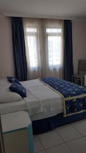 Кровать или кровати в номере Belle Ocean Apart Otel