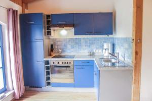 Küche/Küchenzeile in der Unterkunft Ferienwohnungen Ostseestern