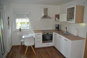 Kuchyň nebo kuchyňský kout v ubytování Im Maifeld