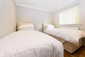 A bed or beds in a room at Vauxhall Apartments