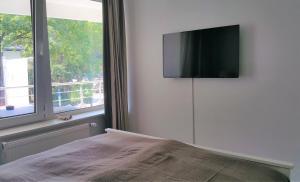 Ein Bett oder Betten in einem Zimmer der Unterkunft HOLI DAY SPA Appartement