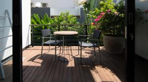 A balcony or terrace at Balissimo Suites Seminyak