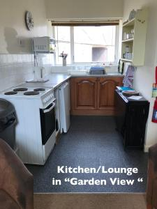 A kitchen or kitchenette at Court Farm Holiday Bungalows Ltd