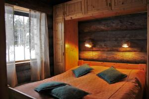 A bed or beds in a room at Villa Tunturituuli