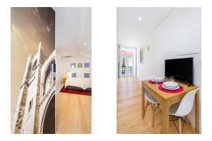 Uma TV ou centro de entretenimento em Porta do Mar | Deluxe Serviced Apartments
