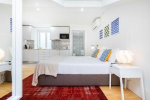 Cama ou camas em um quarto em Porta do Mar | Deluxe Serviced Apartments