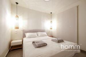 A bed or beds in a room at Breathtaking homm Penthouse with Magical Sea Views