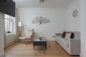 Ein Sitzbereich in der Unterkunft Luxury Marylebone Apartment, Baker Street