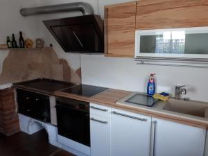 Küche/Küchenzeile in der Unterkunft Ferienhaus mit Wintergarten