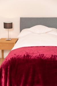 Ein Bett oder Betten in einem Zimmer der Unterkunft Tertianum Parkresidenz Meilen