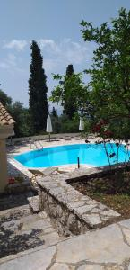 The swimming pool at or near Aliki's Apartments