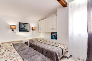 A bed or beds in a room at Apartment Aldea