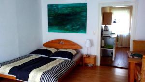 Ein Bett oder Betten in einem Zimmer der Unterkunft Das Fuchsrevier