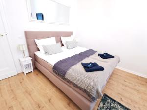 """A bed or beds in a room at Lovely-Flats """"Kamminer VH"""""""
