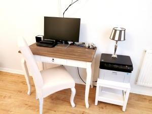 """A television and/or entertainment center at Lovely-Flats """"Kamminer VH"""""""