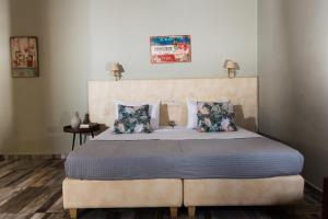 Ένα ή περισσότερα κρεβάτια σε δωμάτιο στο Sarpidon Apartments