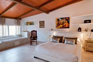 Een bed of bedden in een kamer bij Villa Parralito
