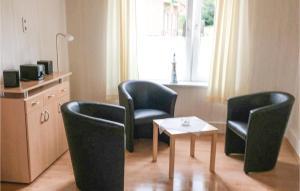 Ein Sitzbereich in der Unterkunft Ferienhaus Im Wiesengrund I