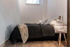 A bed or beds in a room at Residence 85 Amsterdam