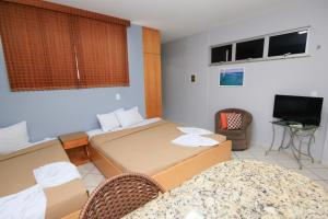 A bed or beds in a room at Residencial BoaVida