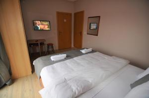 A bed or beds in a room at Apartment LAVO Center