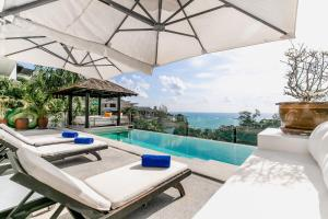 The swimming pool at or near Surin Heights Villa