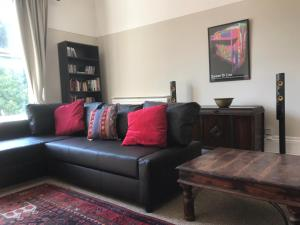 A seating area at Huge Apartment near Lark lane