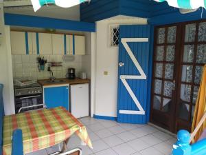 Küche/Küchenzeile in der Unterkunft La Colline Verte