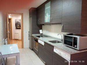 Apartamento amplio y luminoso tesisinde mutfak veya mini mutfak