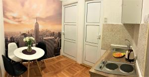 A kitchen or kitchenette at Cicki Apartments II