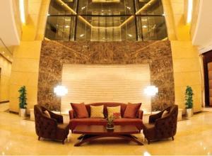 A seating area at Grand Bellevue Hotel Apartment Dubai