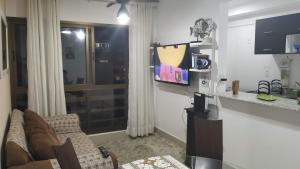 A television and/or entertainment center at Concept Tower Praia Apart
