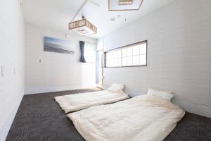 余市亭Yoichiteiにあるベッド