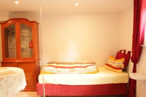 A bed or beds in a room at Casa Susanne