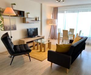 אזור ישיבה ב-Apartamentai Kaunas