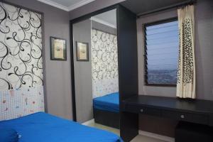 Tempat tidur dalam kamar di GPRO