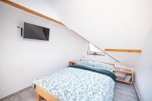 Postelja oz. postelje v sobi nastanitve Apartma Pristov