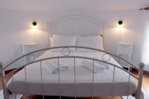 A bed or beds in a room at Anemomilos Studios
