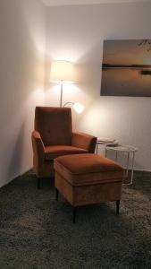 Ein Sitzbereich in der Unterkunft HOLI DAY SPA Appartement